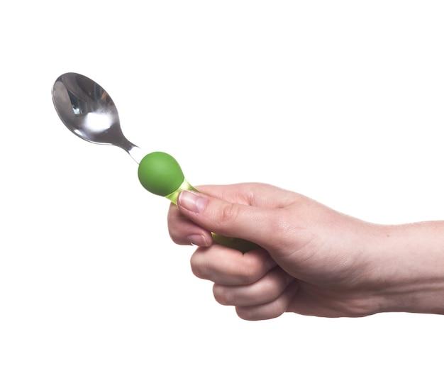 白い背景で隔離の女性の手に台所用品