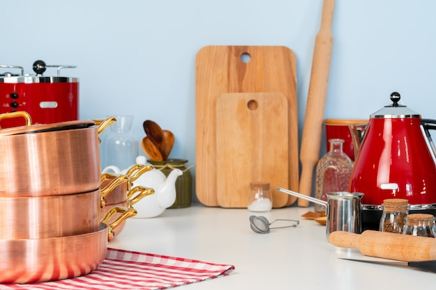 Kitchen utensils on a modern home kitchen table top