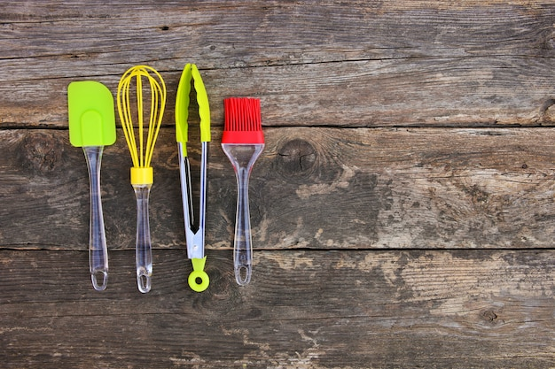 Kitchen utensils on old wooden background. top view. flat lay.