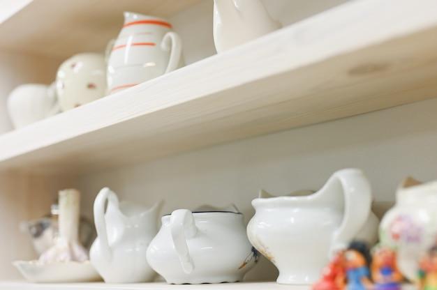 Kitchen utensils on the shelves