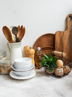 Kitchen utensils, tools and dishware on on the background white tile wall. interior, modern kitchen space in bright colors. blank space for a text, front view