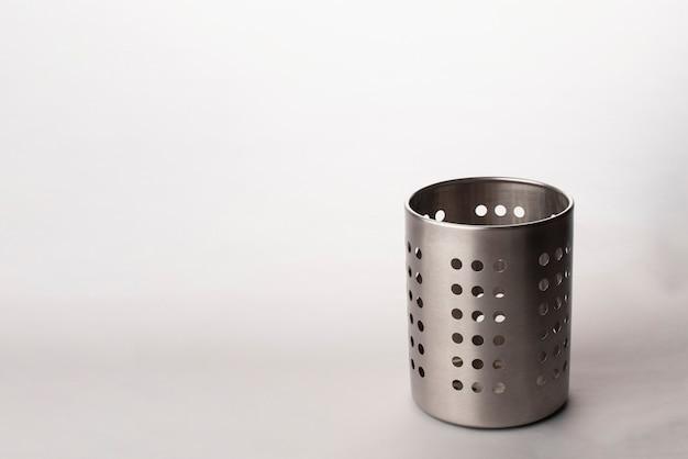 Kitchen utensils in a utensil holder isolated in white background