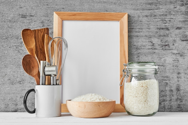 Kitchen utensils and white blank with copy space