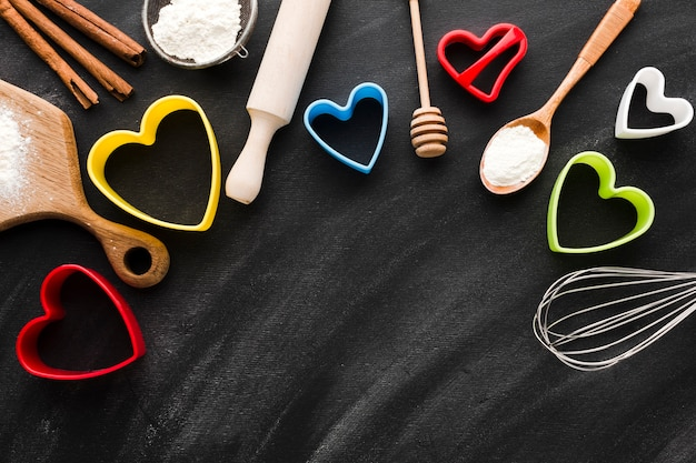 Kitchen utensils with colorful heart shapes