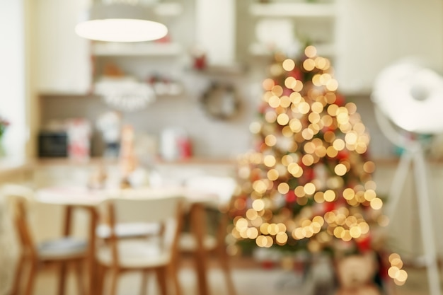 Kitchen with christmas decoration in blurred style