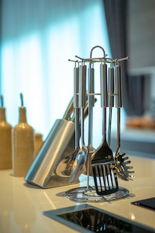 Kitchenware. set of modern kitchen utensil (spatula, whisk and slotted spoon and spaghetti
