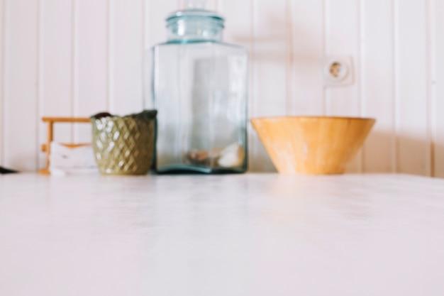 Kitchenware on white table