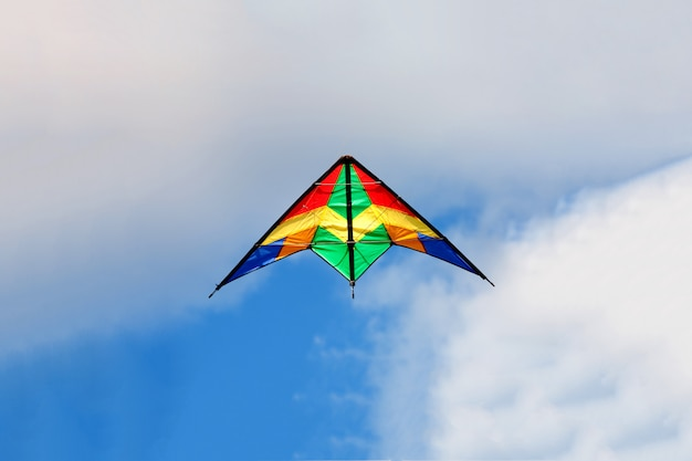 Kite flying on a over blue sky