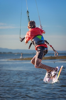 Kite surfer hanging on his kite