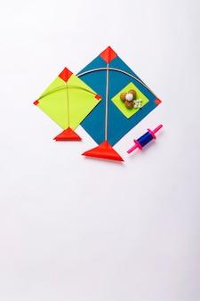 Kite with sesame seed ball and tilgul for indian festival makar sankranti concept