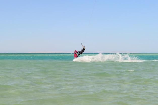 Kiteboarding man on the sea