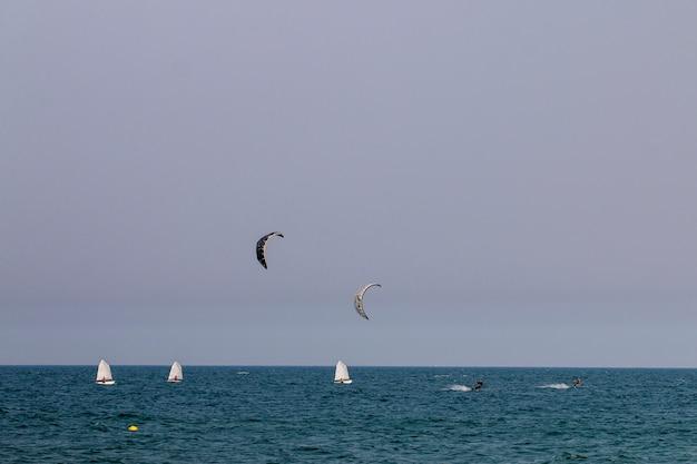 Kitesurf and yacht sailing