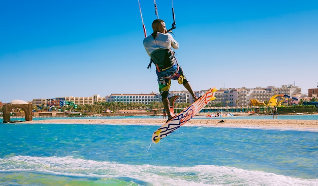 Kitesurfer soaring over the red sea water. egypt.