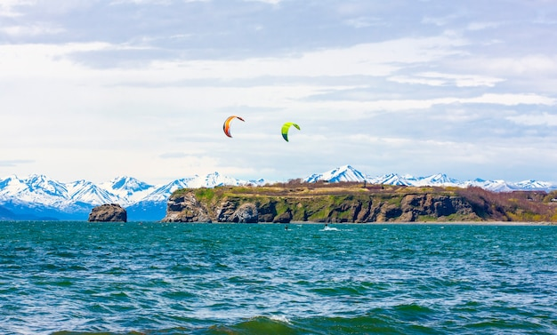 The kitesurfing, kiteboarding, kite surf. extreme sport kitesurfing in kamchatka peninsula in the pacific ocean