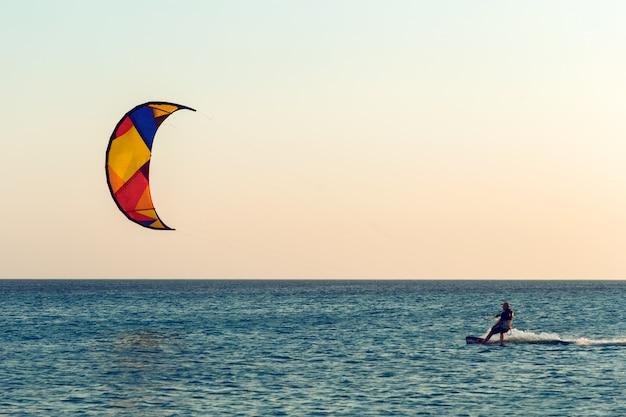 Kitesurfing at sunset at sea