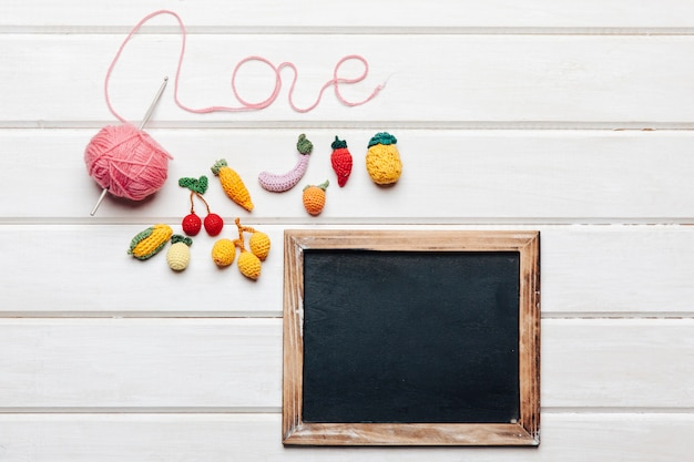 Kitting and love concept with slate
