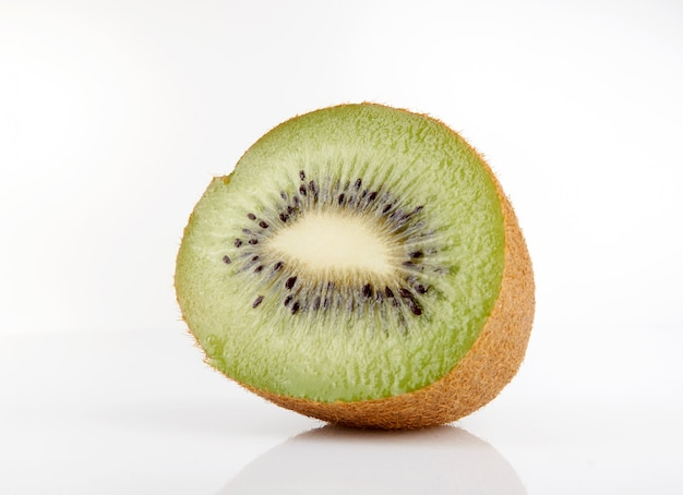 Kiwi cut in half on white