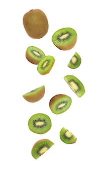 Kiwi fruit falling isolated on white with clipping path.