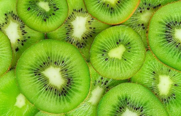 キウイフルーツのパターン。真上にある健康食品の背景。