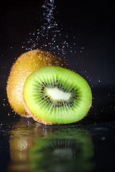 Kiwi fruit with water spray
