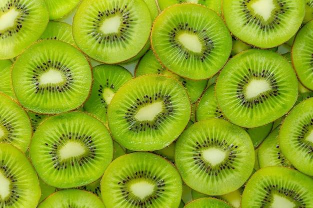 キウイマクロキウイフルーツパターン健康食品の背景オーバーヘッド
