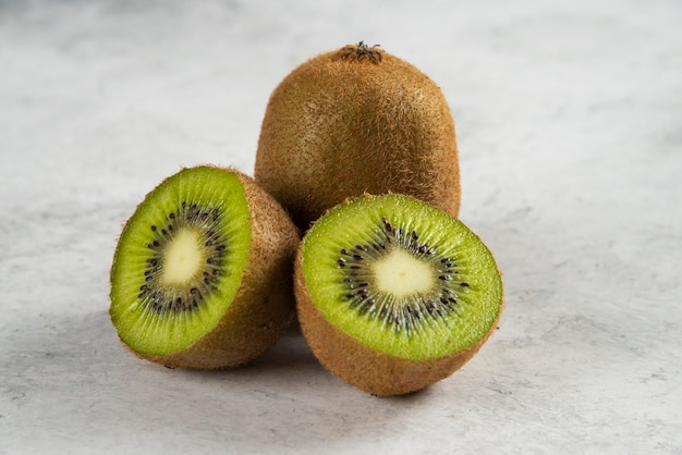 Kiwi sliced pieces on white.
