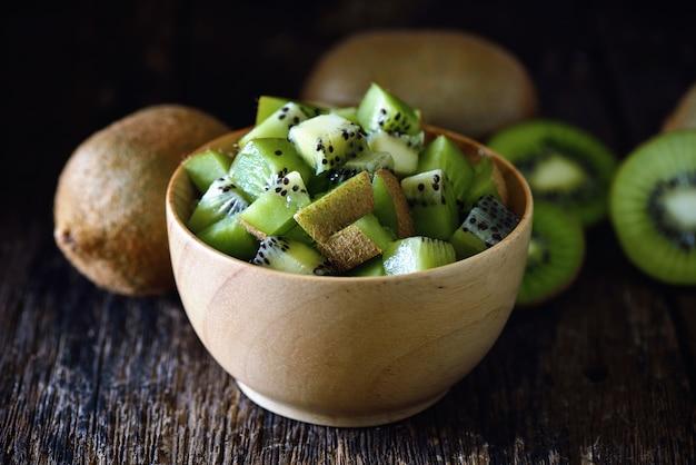 Kiwi in wood bowl
