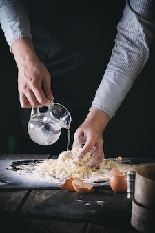 Knead the dough by female hands