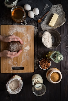 Kneading dough for baking among the ingredients, view from above