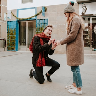 Kneeled man making proposal
