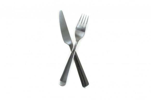 Нож и вилка, столовые приборы, изолированные на белом