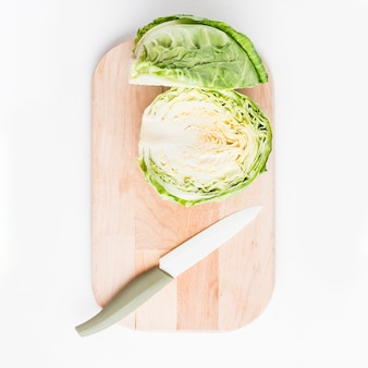Knife and cabbage on cutting board
