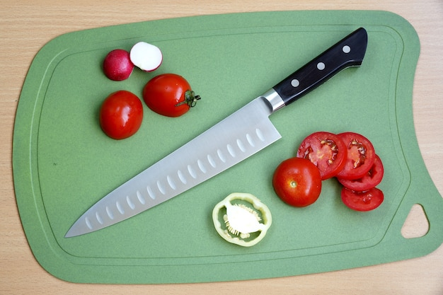 Knife cook universal with a big blade on a chopping board