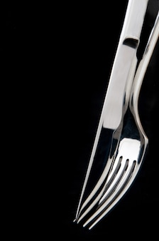 Knife and fork in black background