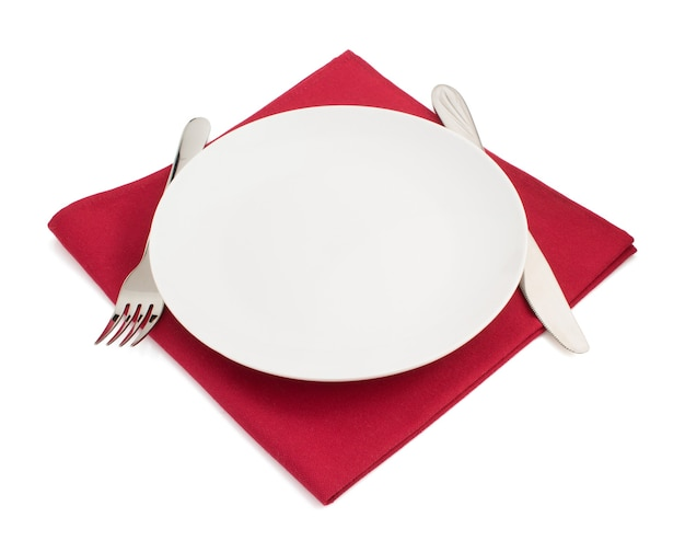 Knife and fork at plate on white background