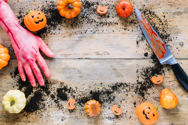 Knife and hand moulage decorated with little pumpkins