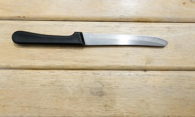 Knife on wood table