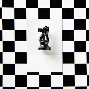 Knight chess piece on a pattern
