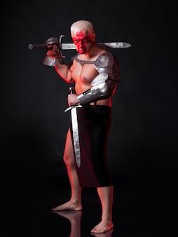 暗赤色の背景に剣を持った騎士