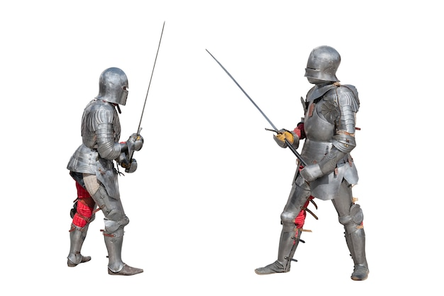 Knights in armor. medieval knights in iron armor hold swords in their hands. duel of the medieval warriors. battle of two knights on swords.