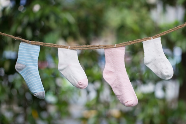 Knitted babies socks on a wooden background