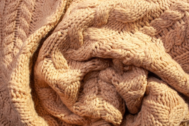 Knitted beige wool sweater background