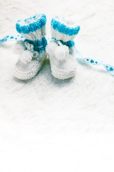 Knitted blue baby booties for little boy