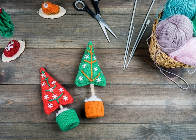 Knitted christmas gifts handmade on wooden background