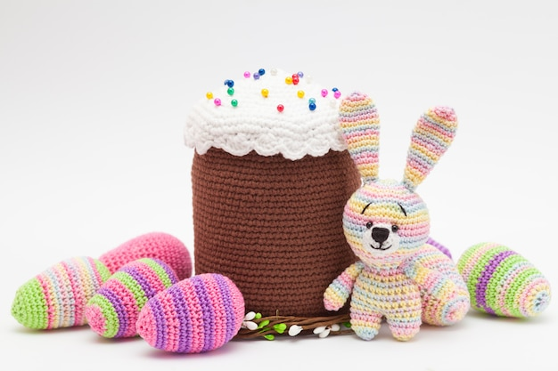 Knitted easter decor eggs, bunny on a white background. handmade, amigurumi