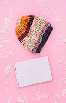 Knitted hat near notebook