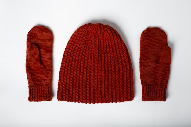 Knitted hat with red gloves isolated
