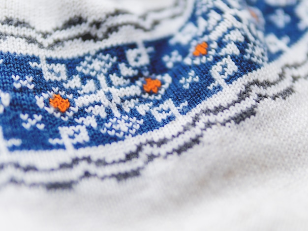 Knitted nordic pattern with blue snowflakes