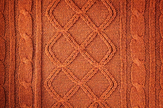 Knitted orange natural wool texture