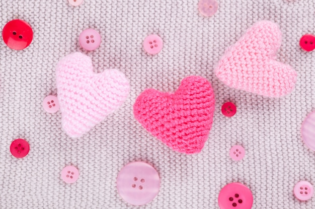 Knitted pink hearts and buttons